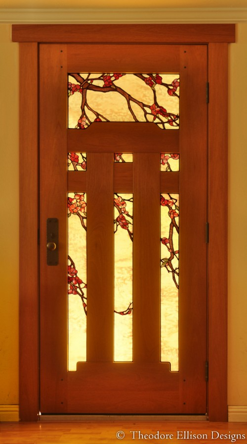 Mahogany door with natural oil finish and flowering branch art glass.